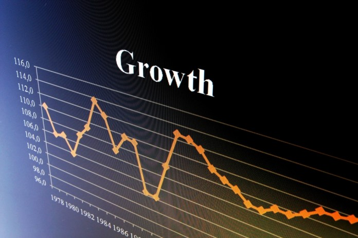 Business output shrinks to four-year low